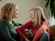 """USA, Utah, Cedar Hills, Mother with teenage girl (14-15) chatting on sofa"""