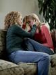 """USA, Utah, Cedar Hills, Mother consoling teenage girl (14-15)"""