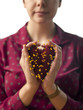 """USA, Utah, Provo, Young woman holding heart-shaped cushion with yellow pins"""