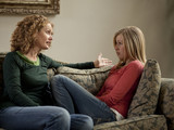 """USA, Utah, Cedar Hills, Mother with teenage girl (14-15) arguing on sofa"""