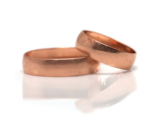 wedding rings with reflection on white background