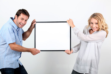 Couple holding message board