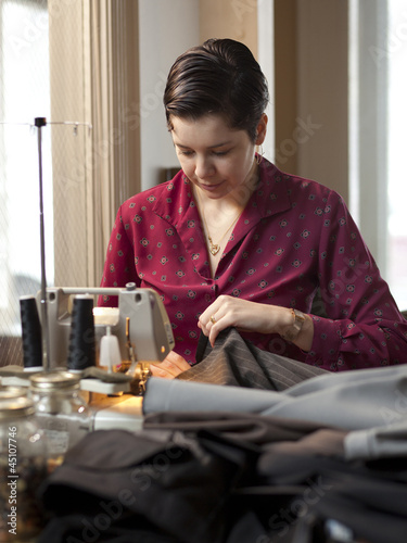 """USA, Utah, Provo, Young female tailor at work"""