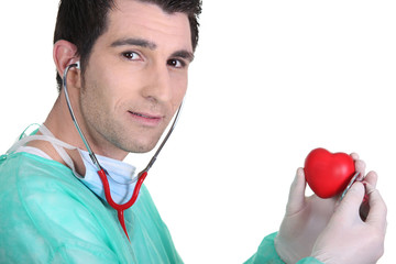 Doctor listening to a heart's heartbeat