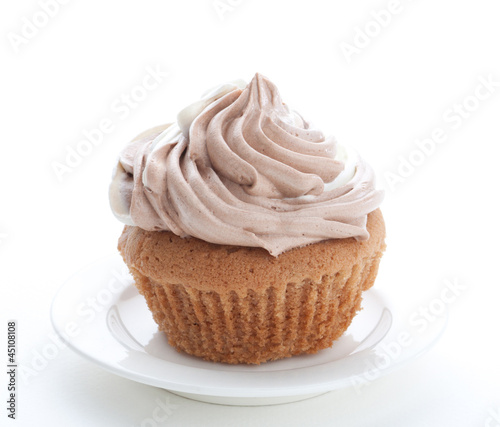 Eatable cupcake with mouse cream isolated