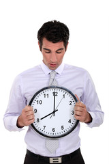 Businessman with a clock
