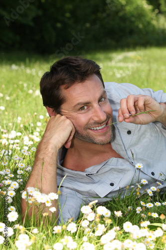 Man lying in a meadow
