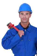 portrait of electrician holding adjustable spanner