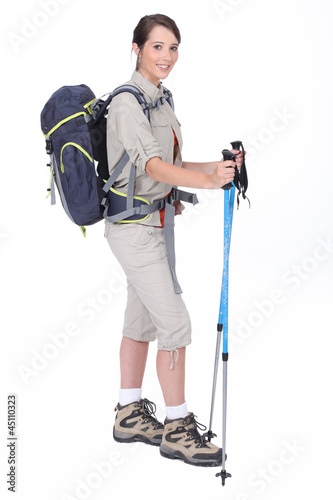 A young woman with hiking gears.