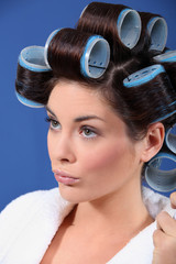 Woman wearing hair curlers