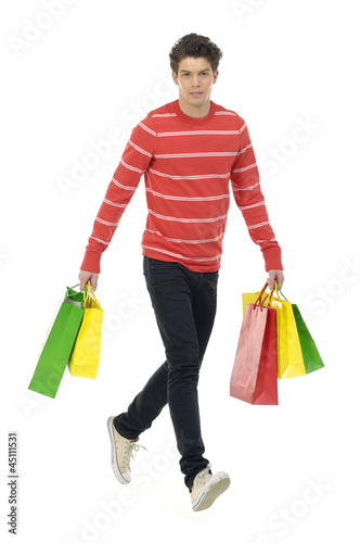 Young man holding shopping bags