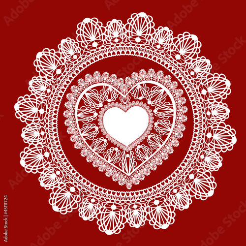 lace heart ornament on red background