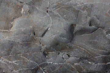 Gray smooth stone with cracks and veins