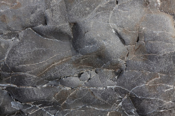 Gray smooth stone with cracks