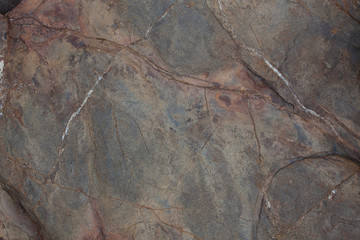 Brown stone with cracks