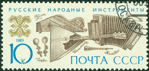 stamp printed in the USSR shows Russian folk music instruments