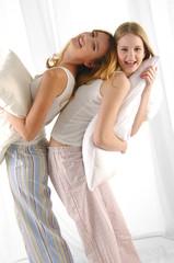 Couple young girl embracing pillow