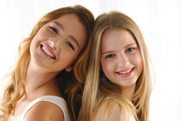 Portrait of two beautiful young women posing together.