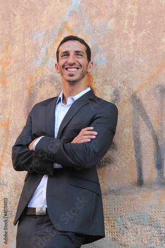 Middle-east businessman standing near a wall