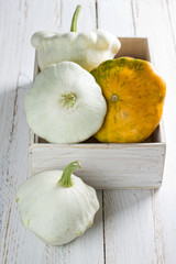 Pattypan Squash in a shabby wooden box