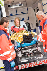 Patient secured in stretcher ambulance paramedics