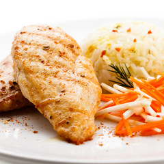 Grilled chicken breasts, rice and vegetables