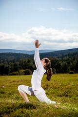 Woman exercising yoga outdoor