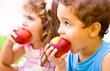 Leinwandbild Motiv Happy children eating apple