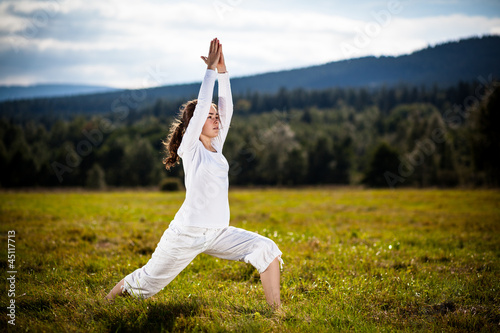 Woman exercising yoga outdoor