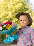 Happy youngster with bouquet of flowers poster