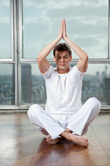 Young Man Practicing Yoga At Gym