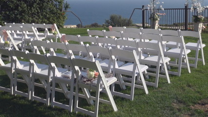 Wedding white chairs on the grass