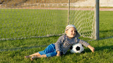 Barefoot youngster with soccer ball poster