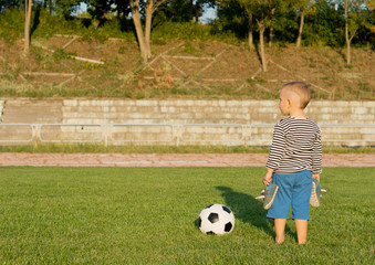 Barefoot boy with soccer ball