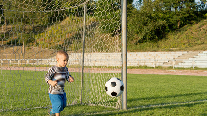 Small boy playing goalkeeper
