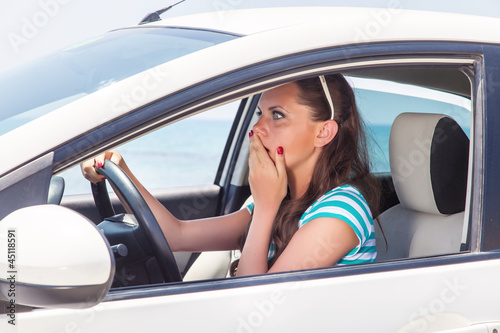 A scared woman is in the car