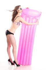 Girl mit rosa Luftmatratze
