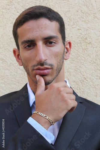 A portrait of a young middle-east man