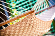 Hammock hanging in the sunny yard, close up photo