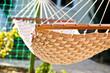 Hammock hanging in the sunny yard, close up photo