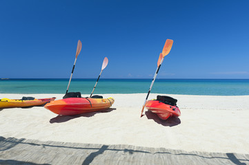 Canoes on beach by the Mediterranean Sea