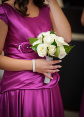 Bridesmaid with bouquet at wedding ceremony