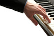 hand of man playing piano