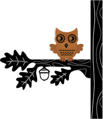 brown owl sitting in dark tree