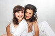 Young couple listens to music in earphones