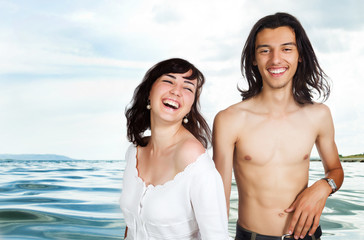 Happy young couple and sea