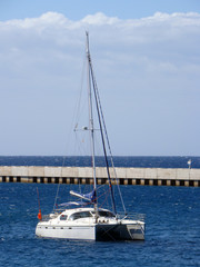 Catamaran anchored near jetty, Spain