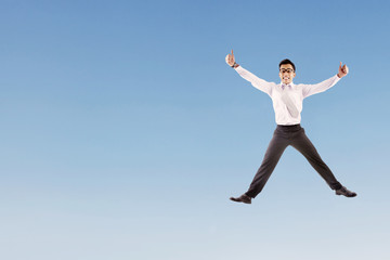 Happy businessman jumping
