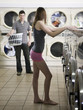 woman taking off her clothes at the laundromat
