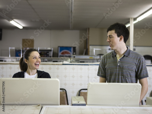 man and woman at a laundromat